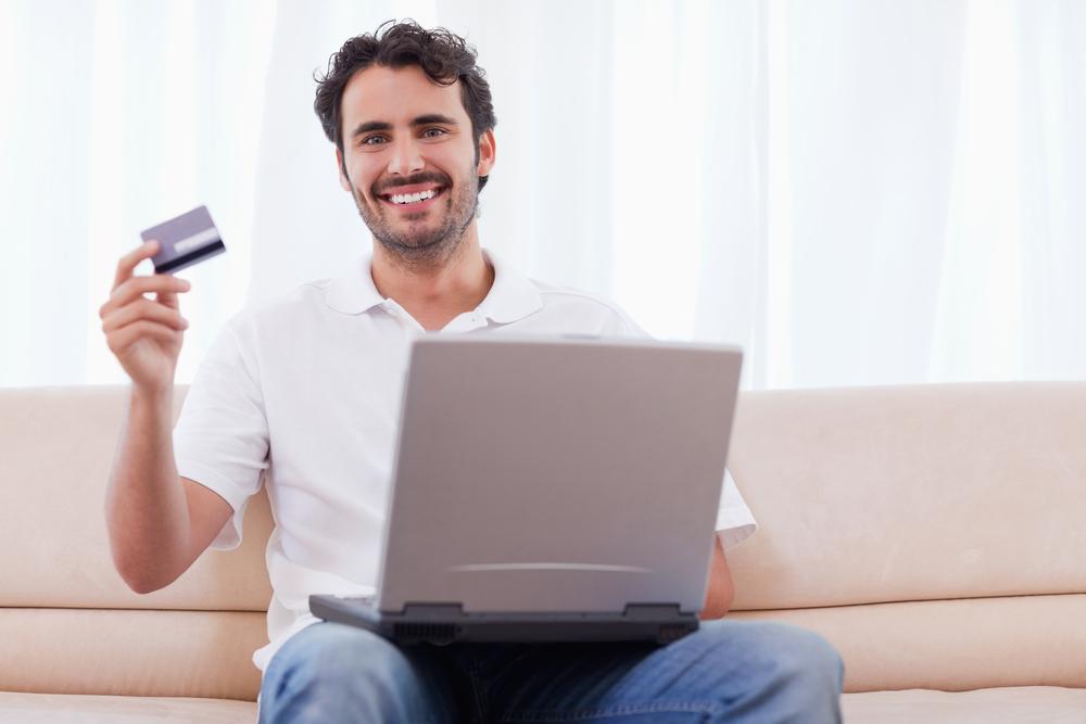 Happy man buying online