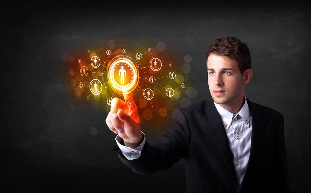 Modern man touching future technology social network button.jpeg
